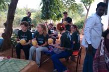 Volunteers enjoying tender coconut before starting the days work